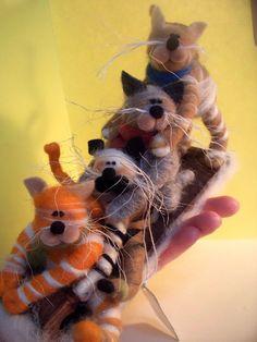 Catastrophe...Four Cats on a toboggan.  http://img3.etsystatic.com/il_fullxfull.291396747.jpg