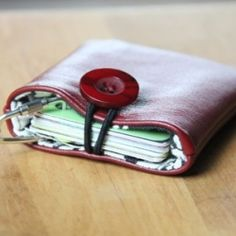 Made from the remnants of an altered leather jacket, this pocket keeps all my cards in one place.