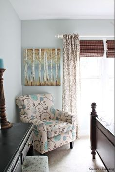 Sherwin Williams Sea Salt shown with the blue undertone coming through a bit more in a transitional country style bedroom
