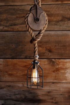 The Wood Wheel Pulley Pendant Light - Rustic Industrial Cage Lighting - Manila R. The Wood Wheel Pulley Pendant Light - Rustic Industrial Cage Lighting - Manila Rope swag Ceiling lamp - Edison bulb hang. Pulley Pendant Light, Rustic Pendant Lighting, Rustic Lamps, Rustic Decor, Rustic Wood, Vintage Lighting, Rustic Modern, Pendant Lamps, Rustic Outdoor