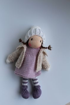 This lovely knitted vest or jacket will fit any of my 8 inch / 20 cm dolls.  It has been handknitted by me from warm and luxurious Jamiesons of Shetland wool yarn. It perfectly fits doll Phoebe (see picture).  Please note that this item does not include the doll from the pictures.