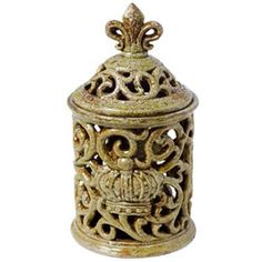 """Pierced Ceramic Canister/Jar/Lantern Green 11""""  FantasticDecor - Home & Garden Accents Regular Price:  $44.99  Our Price:      $26.99-. Set a candle inside, it provides a soft glow of light that illuminates any room. It is made of ceramic and have a antiqued oliver green finish and unfinished areas provide textural contrast."""