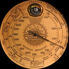 The dial of a Silvertone Sears Model 4465 Tombstone Radio, 1936.  With the green eye when radio is tuned in.