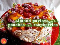 Almond Pavlova with Peaches and Raspberries: A soft but crunchy almond meringue covered with whipped cream and fresh fruit!