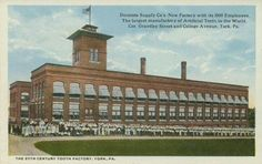 White-border postcard of the Dentists Supply Co.'s new factory at the corner of Grantley St. and College Ave. in York, PA,  c. 1907-1915. Had 1,000 employees and was the largest manufacturer of artificial teeth or dentures in the world. Pub. M. J. Shambaugh of York