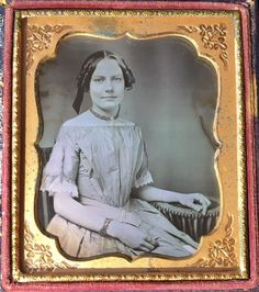 This is a daguerreotype of a gorgeous young woman identified behind the image as Emmett Bolton. Emmett was wearing a beautiful dress with white lace sleeves and a red tinted necklace as well as a bracelet. | eBay!