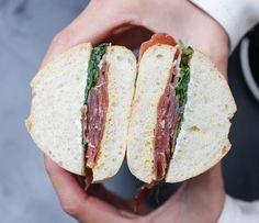 Prosciutto Sandwich with La Quercia Prosciutto, arugula, dijon mustard and butter on sourdough. #butfirstcoffee®
