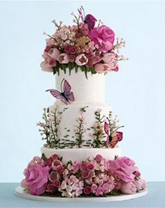beautiful floral and butterfly wedding cake by Sylvia Weinstock