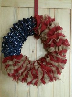 My Burlap and Demin Holiday Wreath. >>great for memorial/4th. Love it! And if you covered the blue jean with herringbone you could use it for Alabama football too :-)