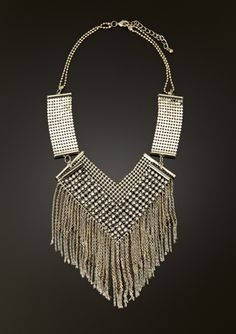 This is one SERIOUS necklace. It literally has little balls and chains on it! Great to toughen up the look