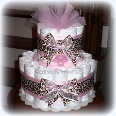 Giraffe diaper cake for a baby girl.  Love the hidden gifts!!  Includes pacifier, fleece blanket, bottle, and diapers.  What a great baby shower decoration and gift idea!!
