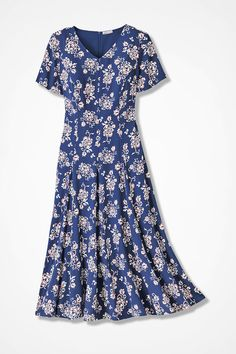 A delightful print in a flattering silhouette that swings and sways with your every move. Fully lined back-zip dress has a V-neck. #FitAndFlare #WomenPlusDress #PlusSizeFashion #PetiteWOmenFashion #VintageDress #ClassicDress
