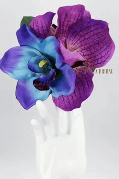 """Spectacular and Rare Hawaiian silk """"Maui Blue"""" Double Orchid and Purple Vanda Real Touch Orchid! Two Sizes Available. Spectacular with hand wired (not hot glued) Blue Crystal Center. Purple Swarovski Crystal in center of Purple Orchid – So very Exotic! Bridal Hair Flowers, Flower Headpiece, Silk Orchids, Silk Flowers, Blue And Purple Orchids, Wedding Pl, Orchid Color, Strictly Weddings, Flowers For You"""