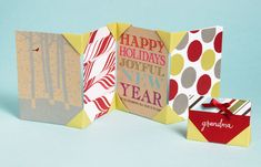Looking for an easy way to display Christmas cards or place cards at your holiday table? In just a few short steps you can create pocketed tabs that hold the corners of the items you want to display. 1. Start with paper cut into rectangular shapes where the width is twice the height 2. Follow...