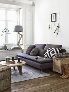 Love the rustic coffee table; vintage industrial side table; plush cube; and textured pillows.