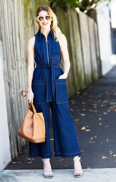 Natalie Cantell in a denim jumpsuit, square sunglasses, and strappy sandals