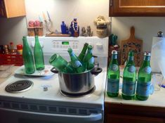 Just low heat bottles in water to easily remove labels.