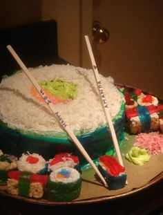 DIY Sushi Cake + treats on the side. I made it for my sister's 20th :)
