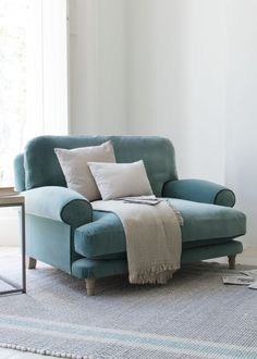 The kind of loveseat that demands you sit in it rather than on it. Absolutely no perchers, please!