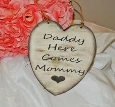 Hey, I found this really awesome Etsy listing at https://www.etsy.com/listing/188281041/daddy-here-comes-mommy-wood-heart-sign