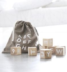 Traditional learning has never looked more beautiful than these wooden alphabet blocks from Ooh Noo. Set of 10 blocks are printed with the alphabet and Wooden Alphabet Blocks, Wooden Baby Blocks, Letter Blocks, Wood Blocks, Letters, Traditional Toys, Diy Bebe, Linen Bag, Montessori Toys