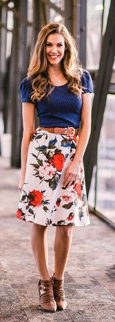 This gorgeous Tuck Pleat Skirt is a fabulous knee length A-line skirt with blooming roses printed on it. It's un-fussy floral, is sure to put a spring in your step! Pair this pleated skirt with the ro
