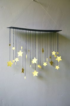 Raining Stars Mobile van shopprettythings op Etsy Change to six pointed stars and use a painted branch to hang them.