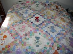 Irish Chain Sunbonnet Sue Quilt Top.  One of these days I am going to be able to make a quilt like this one.  I love pieced and appliqued quilts.