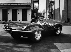 Jaguar XKSS. Steve McQueen pictured in his beloved 'Green Rat'. He spotted this car parked in a studio lot on Sunset Boulevard in 1958.  This rare machine was one of only 16 to hit the streets before a fire at Jaguar finished the conversions. McQueen paid $5,000 for his off-white model, then respraying it British Racing Green and having friend Tony Nancy re-craft the red interior in stitched black leather.
