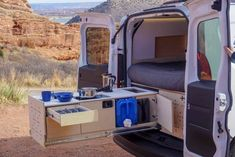 The Cargo Van Conversion kit comes with two slide-out drawers to create an outdoor kitchen. If you want a car camper, Contravans builds campervan conversion kits that fit in SUVs, minivans and small cargo vans. You'll be camping in no time! Truck Camper, Kombi Motorhome, Camper Trailers, Camper Life, Rv Campers, Small Camper Vans, Small Campers, Mini Camper, Vw Camper Vans