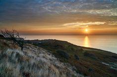 Sunrises by Fairlight //// #fairlight #sunrise #sussex #coast #tree #red #gold #sun #water #coast #uk #england #cliff #sonya6000 #nisifilters #captureone #ndgrad #every3secondsadonkeycries