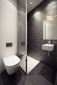 A small shower stall and floating sink in a tiled bathroom add a practical if cozy final touch.