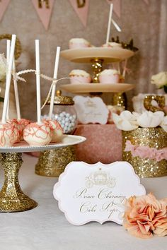 Those cake stands are made from dollar store candle sticks, white plates and gold glitter. Perfect!
