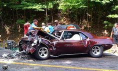 A woman in a Ford Escape tried to pass another car going up a hill and hit this 69 Camaro head on killing the driver who had his son with him. Very sad.