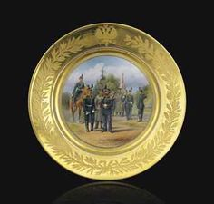 A PORCELAIN MILITARY PLATE -  BY THE IMPERIAL PORCELAIN FACTORY, ST. PETERSBURG, PERIOD OF ALEXANDER III, 1881  Circular, the center painted with officers on foot & horseback, within a gilt border impressed and ciselé with the Imperial double-headed eagle above a ribbon-tied wreath of laurel & oak leaves, inscribed on the reverse in Russian 'First Grenadier Division after the painting by Balashov signed N. Semenov 1881,' marked under base with green underglaze factory mark  9¾ in. diameter