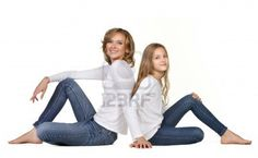 young mother with daughter sitting isolated on white Stock Photo - 15489703