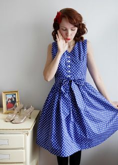 Blue polka dot dress, and take a gander at those shoes!