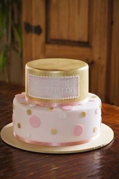 Tiered pink and gold sparkle baby shower cake with polka dots