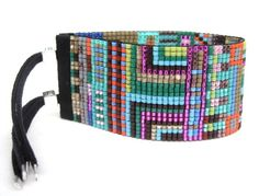 I love these colorful cuffs by Julie Rofman