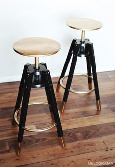 "This is a picture of DALFRED's Ikea bar stool makeover. I love the black and gold detail, though I think I prefer the seats black with gold details rather than all gold. Other than that, I think it's perfect! It's glamorous, but not attention-grabbing. It's modern, chic, sexy, and low-key. My only concern is that it does not seem comforting or ""cushy"" enough, but I think this is alright because this is more of a space-saver idea."