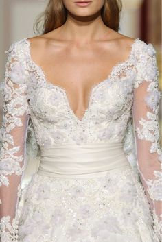 Now that's a beautiful neckline on a wedding dress. So much better than those misfitting strapless numbers.