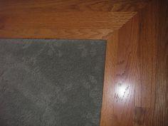 Carpet inlay wood floor bordering 3 feet around room wall to wall carpet center