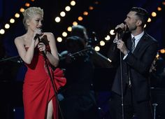 """The fact that Gwen Stefani's Versace dress was red during her performance with Adam Levine was fitting, because their performance was on fire! """"The Voice"""" coaches looked flawless and sounded incredible as they sang Maroon 5's """"My Heart Is Open."""" Did we mention that these two looked incredible?"""