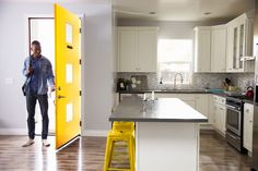 Coming home to a modern home entryway and island kitchen featuring an exterior fiberglass yellow prefinished front door with modern spotlights Exterior Doors, Interior And Exterior, Fiberglass Entry Doors, Glass Door, Island Kitchen, Spotlights, Wood, Project Ideas, Modern