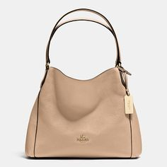 5e3e04c1374d edie shoulder bag 31 by COACH. The new Edie 31 combines easy
