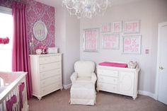 alphabet wall and pink flocked wallpaper in baby girls room