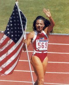 Florence Delorez Griffith Joyner, also known as Flo-Jo, was an American track and field athlete. She is considered the fastest woman of all time based on the fact that the world records she set in 1988 for both the 100 m and 200 m still stand. Flo Jo, Usa Olympics, Black Goddess, Sport Icon, Still Standing, World Records, Track And Field, Olympians, Black History
