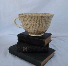 sheet music/old book pages, modpodge and an ugly cup = pretty sweet