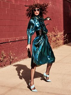 Bringing the shine factor, Catherine McNeil models Ellery blue metallic dress with patent-leather shoes by Blumarine for Allure Magazine December 2016 issue