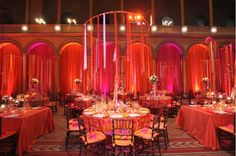 hula hoops with ribbons or hanging candles.  Cheap, easy and add height to tablescapes even if centerpieces are low.